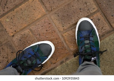 plaid shoes on a brick walkway - landscape