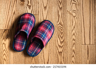 Plaid slippers background with copy space.