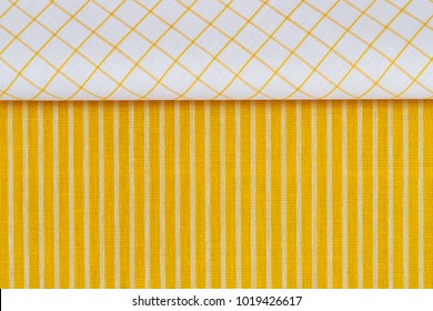 Plaid white yellow fabric border on  Striped yellow white fabric texture. Linen cloth frame as Easter background. Striped yellow white fabric texture. Linen cloth surface as Easter Yellow cloth backgr