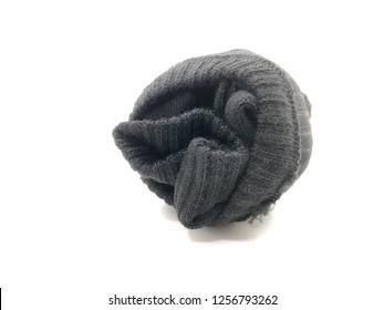 Plain Black Rolled Up Socks on White Background