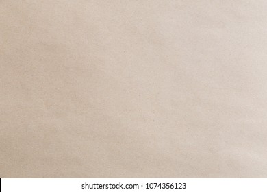 Plain brown eco paper texture in scrap canvas backdrop photo concept for letter craft design package box background. Pattern back of smooth parchment rice recycle surface and earth tone.
