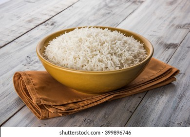 Plain cooked Indian white basmati rice in a ceramic bowl over colourful background. selective focus