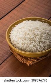 plain cooked white basmati rice in a ceramic bowl, selective focus