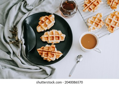 Plain Croissant Waffle or Croffle and a cup of coffee with white background.