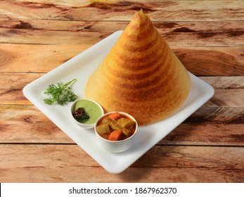 Plain Dosa, a south Indian traditional and popular Breakfast served with chutney and sambar over a rustic wooden background, selective focus - Shutterstock ID 1867962370