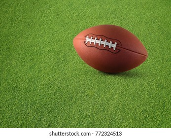 Plain football on synthetic turf grass.