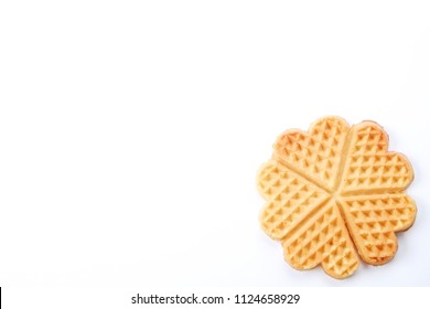 Plain freshly baked homemade heart shaped Belgium waffles isolated on white background. European baked pastry sweets. Copy space, close up, top view, flat lay. St. Valentine's Day breakfast concept.
