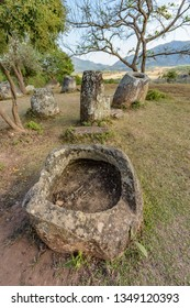 The Plain of Jars site 3 sits on a scenic hillside in pretty woodland near the village of Ban Lat Khai, Phonsavan, Xieng Khouang Province.