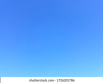 Plain light blue sky without clouds