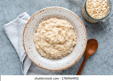 Plain oatmeal porridge in bowl. Healthy vegan vegetarian breakfast food, whole grain porridge oats - Shutterstock ID 1784964902