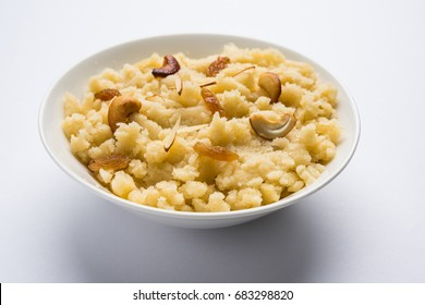 Plain Semolina/Suji Halwa also known as Sweet Rava Sheera OR Shira - Indian festival sweet garnished with dry fruits. Served in a plate or Bowl, selective focus