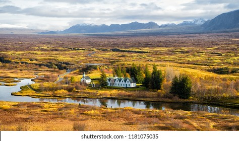 plain thingvellir national park in reykjavik enters to the iceland golden circle. countryside with river, church, houses on mountain landscape in Iceland. best vacations. perfect morning