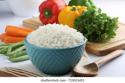 plain white cooked rice bowl with vegetable