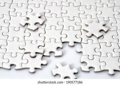 Plain white jigsaw puzzle. (isolated on white background.)