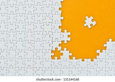 Plain white jigsaw puzzle. (yellowish brown background)