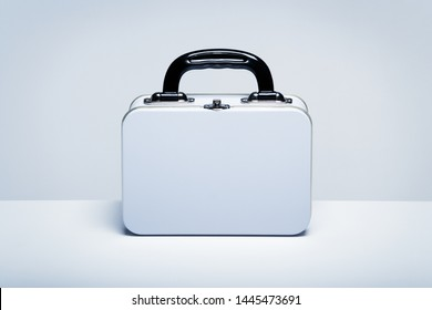 Plain white metal lunchboxes with copy space on white table