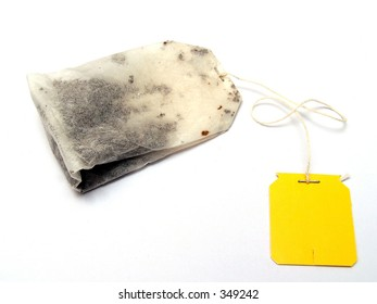 A plain yellow tagged tea bag with clear background