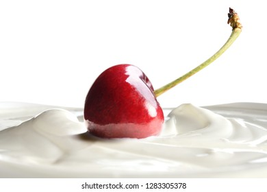 Plain yogurt with fresh cherry on top isolated on white background