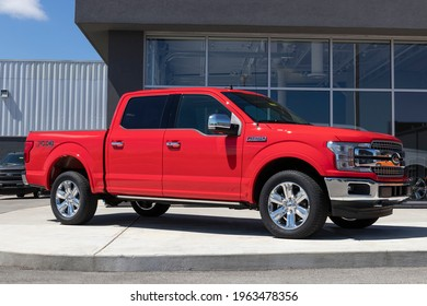 Plainfield - Circa April 2021: Ford F150 display at a dealership. The Ford F-150 is available in XL, XLT, Lariat, King Ranch, Platinum, and Limited models.