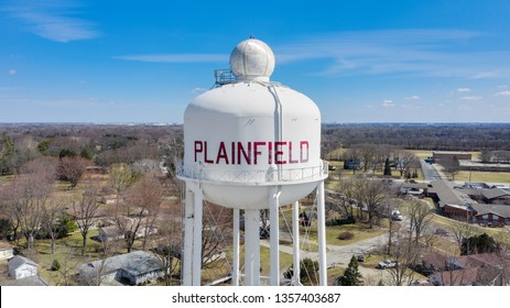 PLAINFIELD, IL, USA - MARCH 19, 2019:  A drone / aerial view of a white water tower with Plainfield painted in red.