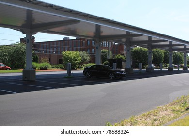 PLAINVILLE, CT., USA-MAY 28: General Electric Solar carport powers up-Electronic Carport, automobile charging station in Plainville, Connecticut, USA