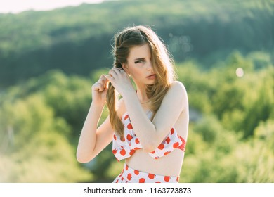 Plait concept. Pretty woman plait hair in braid on summer nature. Young girl style hair in plait. Can you plait your hair like this.