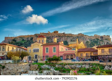 Plaka Athens with the rock of Parthenon at the background.