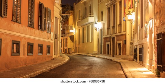 Plaka, Athens, traditional buildings at the sides of an illuminated street. Architecture in Greece.