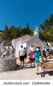 Plaka, Crete, Greece. October 2019.  The Saint Marina church in Plaka, Crete, Visitors on a guided tour.
