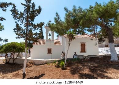 Plaka, Crete, Greece. October 2019.  The Saint Marina church in Plaka, Crete, Visitors sitting outside.