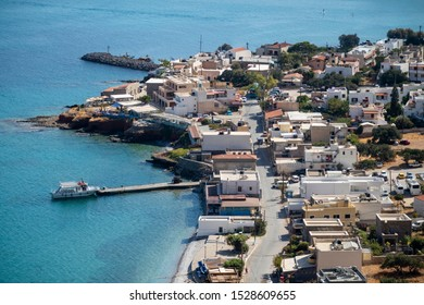 Plaka, Crete, Greece. October 2019, Plaka, an overview of the town and jetty where ferries leave for Spinalonga Island depart. Eastern Crete.