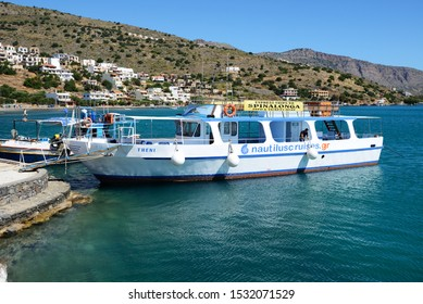 PLAKA, GREECE - MAY 14: The motor yacht tour to Spinalonga island on May 14, 2014 in Plaka, Greece. Up to 16 mln tourists is expected to visit Greece in year 2014.