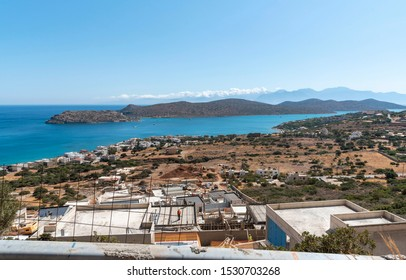 Plaka, Lisithi, Crete, Greece. October 2019.  Building development of new homes on the mountainside in Plaka, Crete with a view of Spinalonga Island.