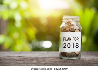 Plan For 2018 Word With Coin In Glass Jar.