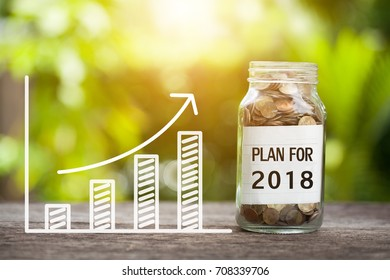 Plan For 2018 Word With Coin In Glass Jar and graph up.