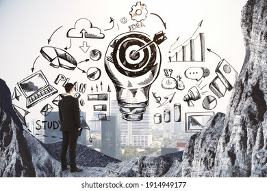 Plan to achieve the goal concept with businessman in the mountain and drawn sketch of business ideas. Double exposure.