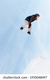 Plan de Gralba, Italy, February - 04. 2010.Young extreme skiers jump on an inflatable airbag in Dolomiti mountain near Sella Ronda.