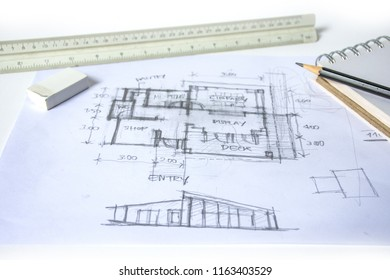plan and elevation of home preliminary design sketch by black pencil on white paper and white background with drawing tools, scale rulers, rubber, small sketch book, selective focus