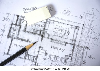 plan of home preliminary design sketch by black pencil on white paper and white background with drawing tools, rubber, selective focus