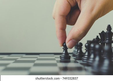 Plan leading strategy of successful business leader concept, Hand of player chess board game putting black pawn, Copy space for your text