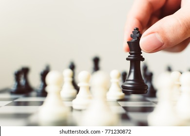 Plan leading strategy of successful business competition leader concept, Hand of player chess board game putting black pawn, Copy space for your text