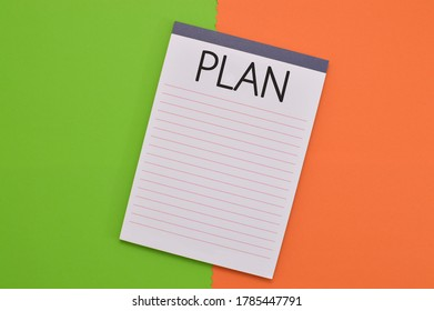Plan Lined Notebook on Green and Orange Background