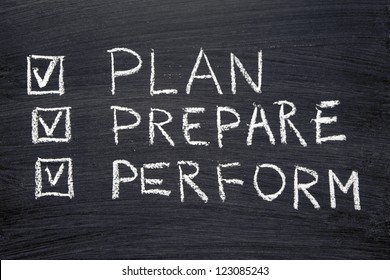 plan, prepare, perform words handwritten on chalkboard with marked check-boxes