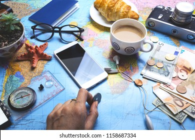 Plan of trip. background - Women's hands and map, retro camera, money, compass