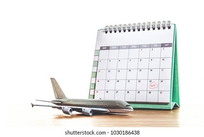 plan for trip (calendar and airplane model)