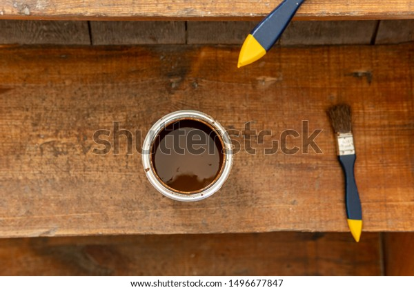 Plan view of a paint pot and brush to paint a wooden staircase