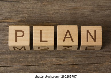 PLAN word on a wooden background