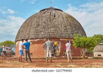 Planalto, Rio grande do sul / Brazil -October 2018 : Unidentified people working in a bioconstruction site, permaculture building, in a indigenous tribe.