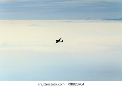 Plane above mist and clouds