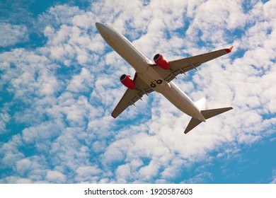 Plane after take off with cloudy sky, Below plane after take off, Passenger plane take off with blue sky, White passenger plane take off